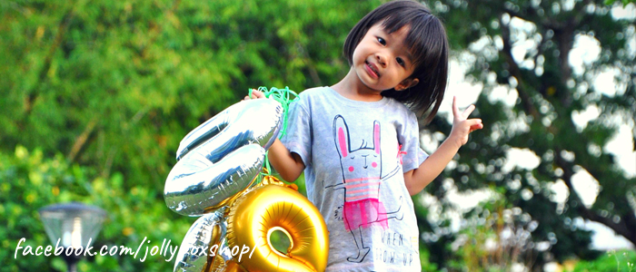 Little Jolly Box Model Posing With Our Letter Foil Balloons